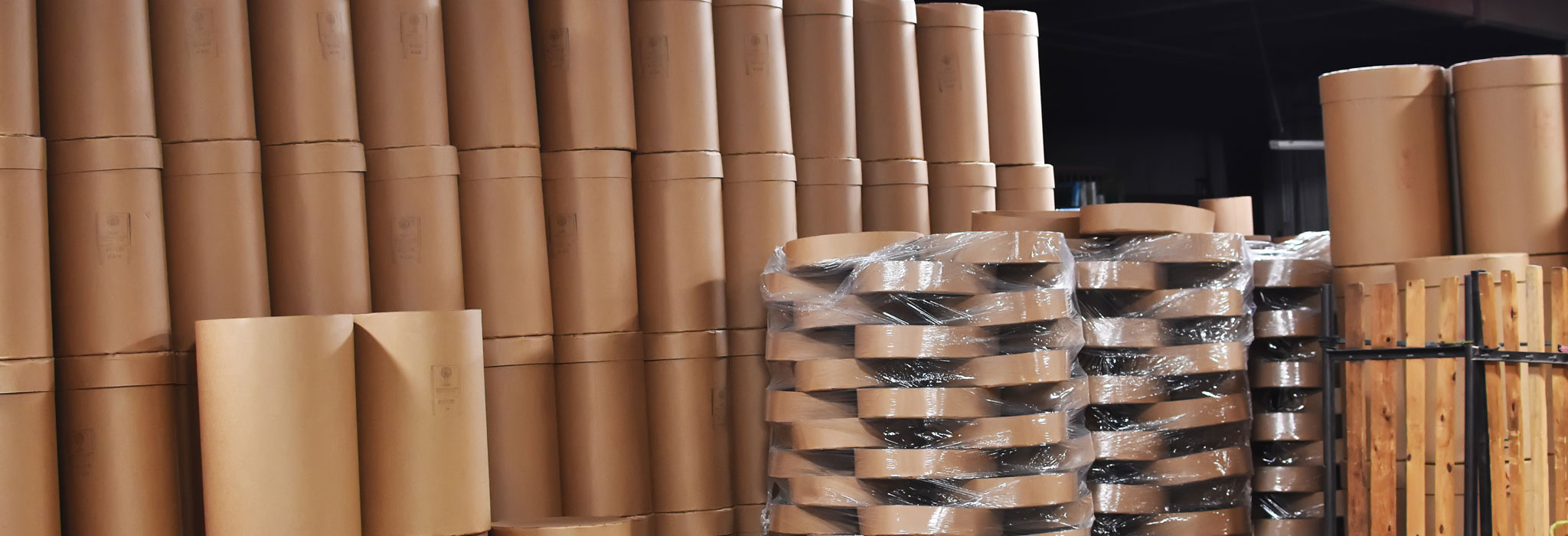 fibre barrels with plastic wrap ready to ship to customers The Master Package Fibre Shipping Containers